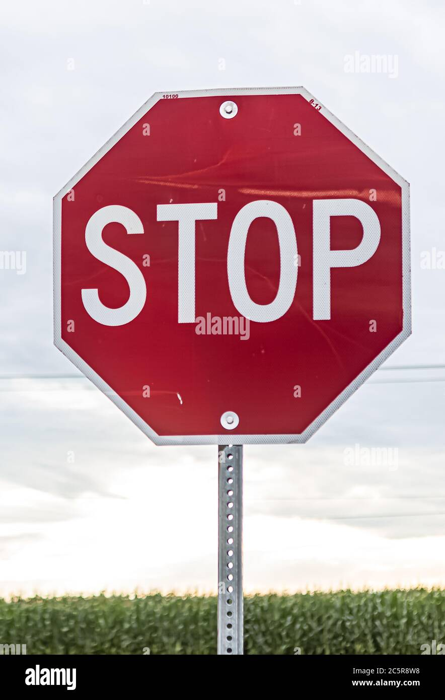 Stop sign for traffic against cloudy sky Stock Photo