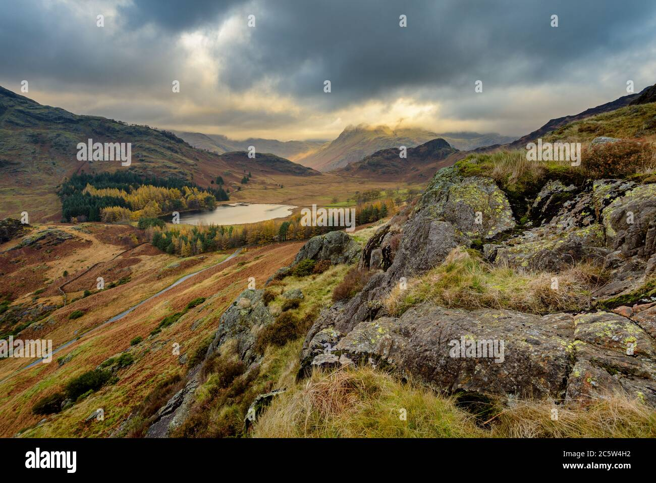 Dramatic View Of Blea Tarn From High Up With Storm Clouds On An Autumn Morning. Lake District, UK. Stock Photo