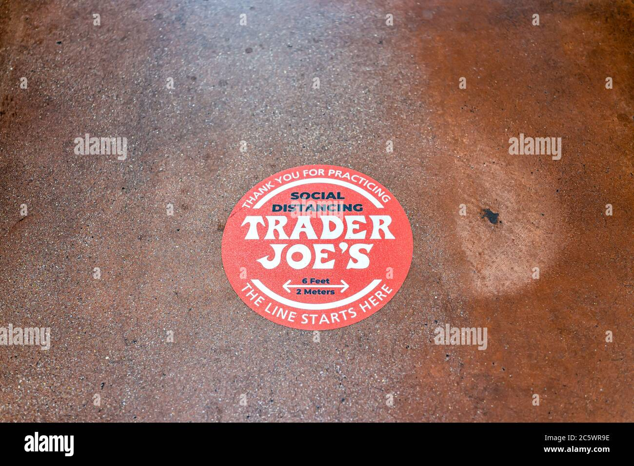 Reston, USA - May 28, 2020: Above view for red warning sign to maintain social distance distancing during covid-19 coronavirus outbreak in Trader Joes Stock Photo