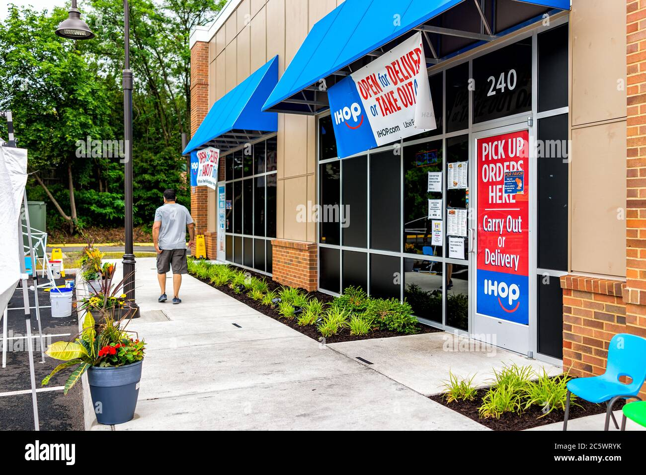 Herndon, USA - June 11, 2020: Virginia Fairfax County street with building exterior sign for open ihop restaurant for take-out and delivery during cor Stock Photo