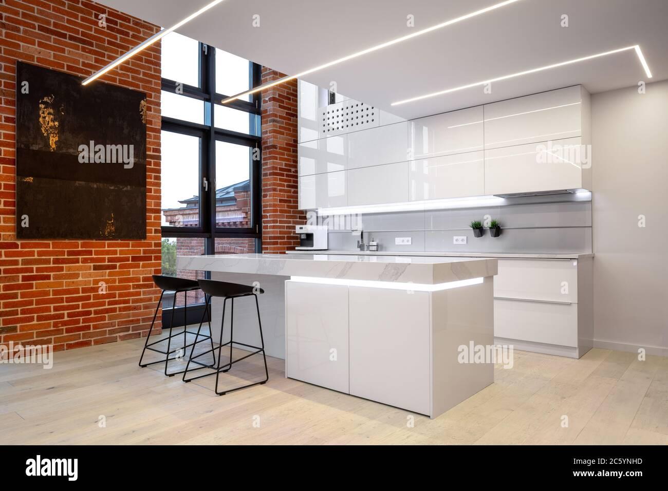 Luxury White Kitchen Interior With Loft Style Brick Wall And Big Window Stock Photo Alamy