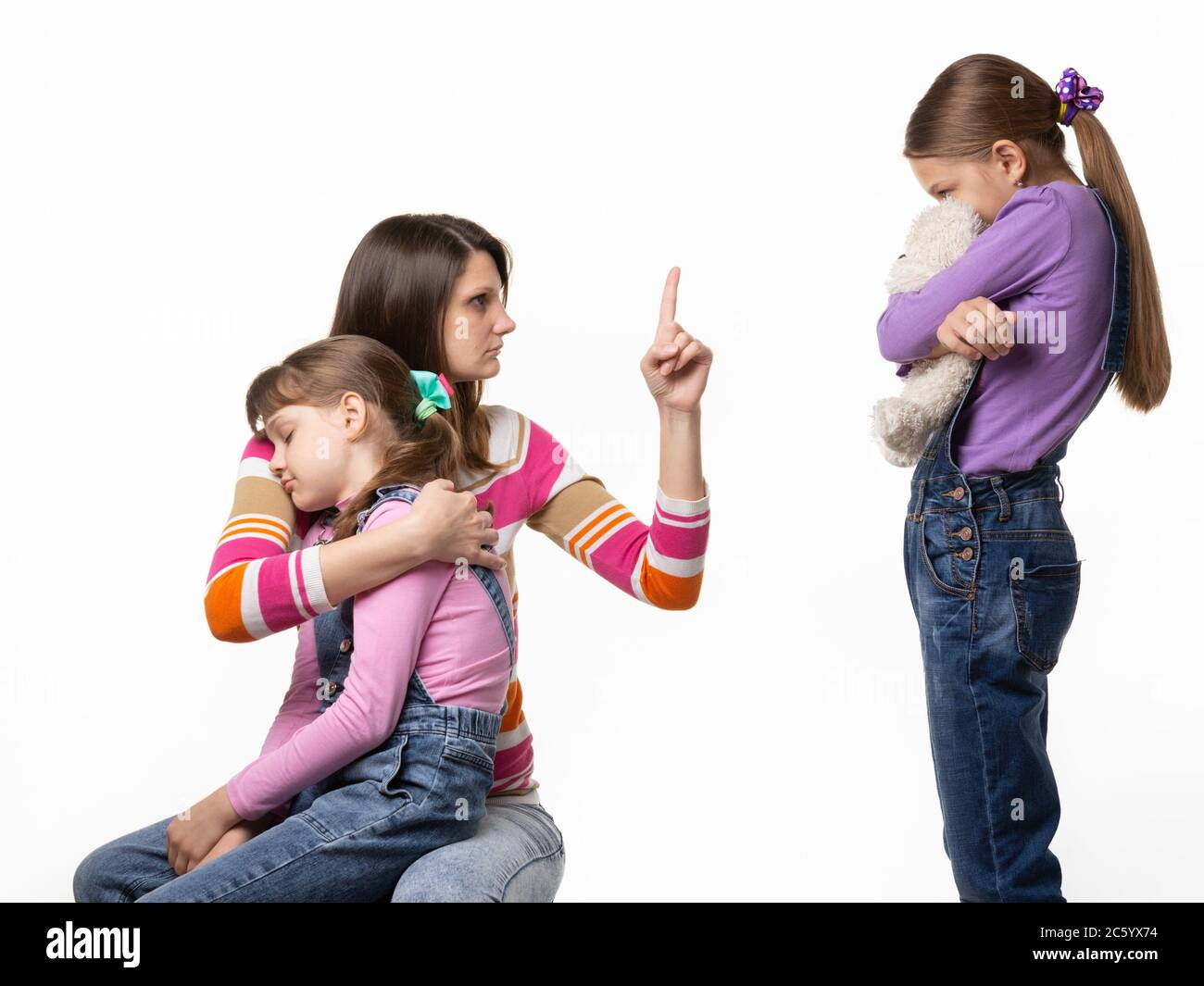 Mom talks hard with her daughter for offending her sister. Stock Photo