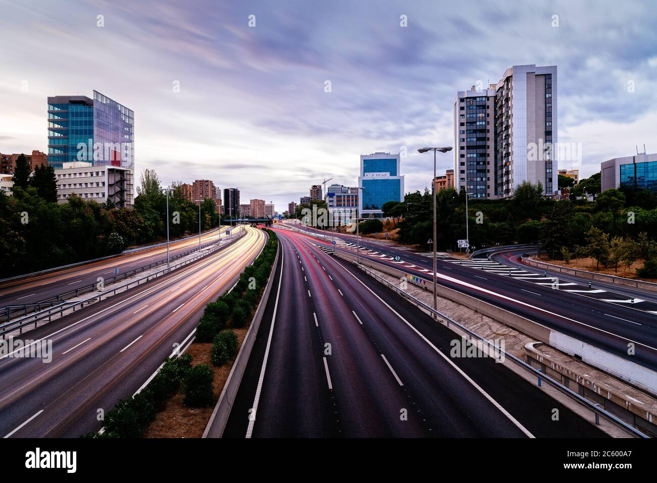 M30 motorway in Madrid at sunset. Long exposure with traffic light trails. Stock Photo