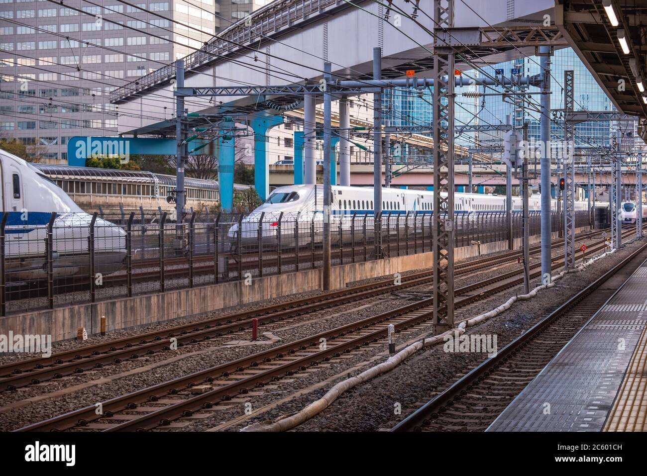 At the train station in Tokyo, Japan, where the train is coming in, Stock Photo