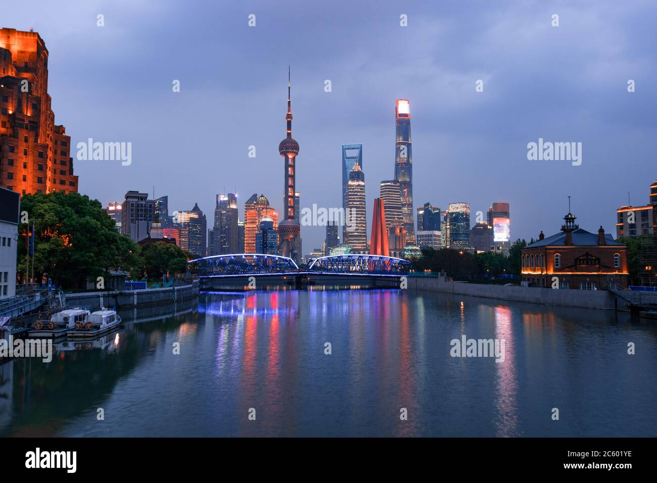 Night view of Waibaidu bridge and Lujiazui, the landmarks of Shanghai, China, with reflection in front. Stock Photo