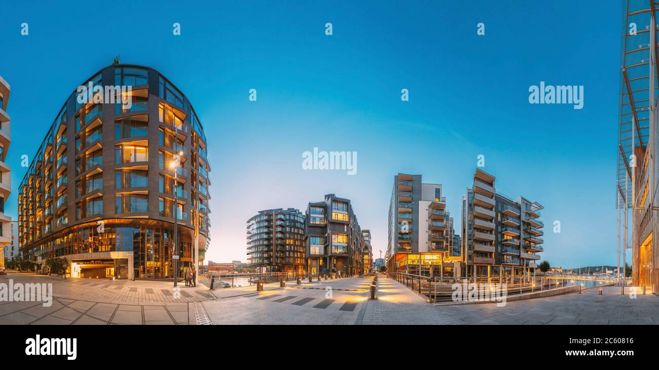 Oslo, Norway. Night View Of Residential Multi-storey Houses In Aker Brygge District. Summer Evening. Residential Area. Famous And Popular Place. Stock Photo