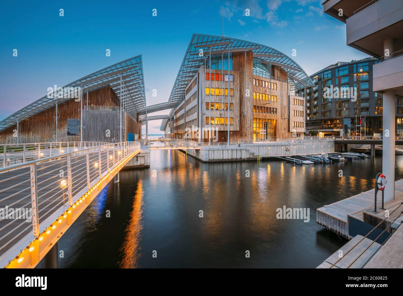 Oslo, Norway. Museum of Modern Art In Residential Multi-storey Houses In Aker Brygge District In Summer Evening. Famous And Popular Place. Stock Photo