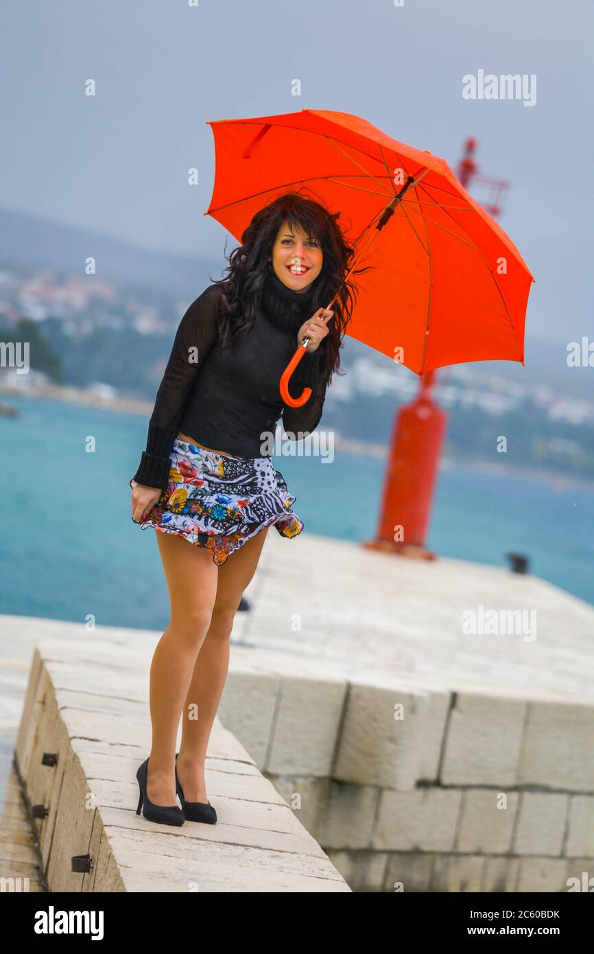 Teen girl with Red umbrella in hands Stock Photo
