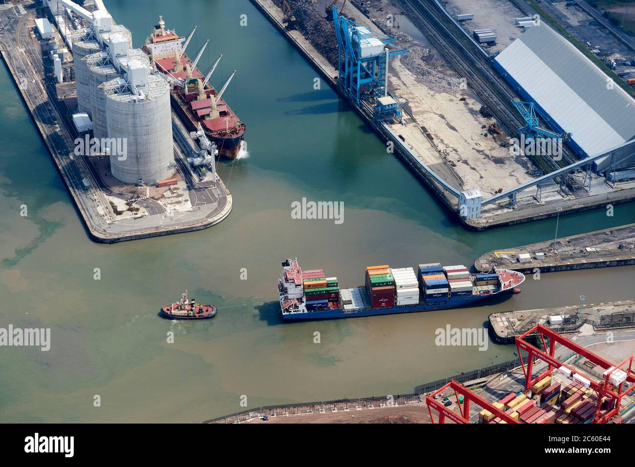 An aerial view of a container ship leaving Seaforth Docks, Liverpool, Merseyside, North West England, UK Stock Photo