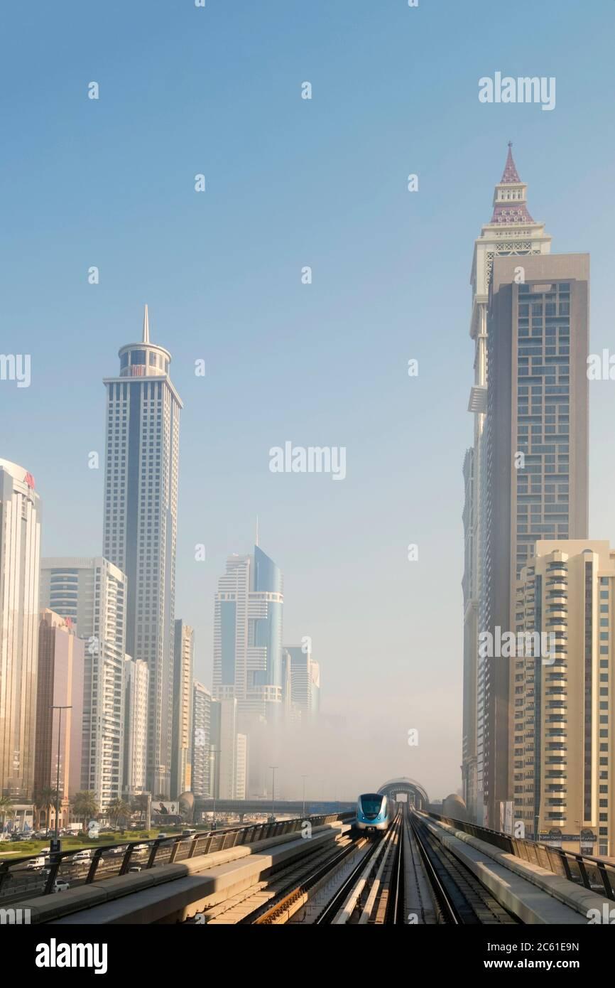 Dubai Metro and CBD, public transport, subway, metro line and tall buildings in the city centre, Dubai, United Arab Emirates Stock Photo