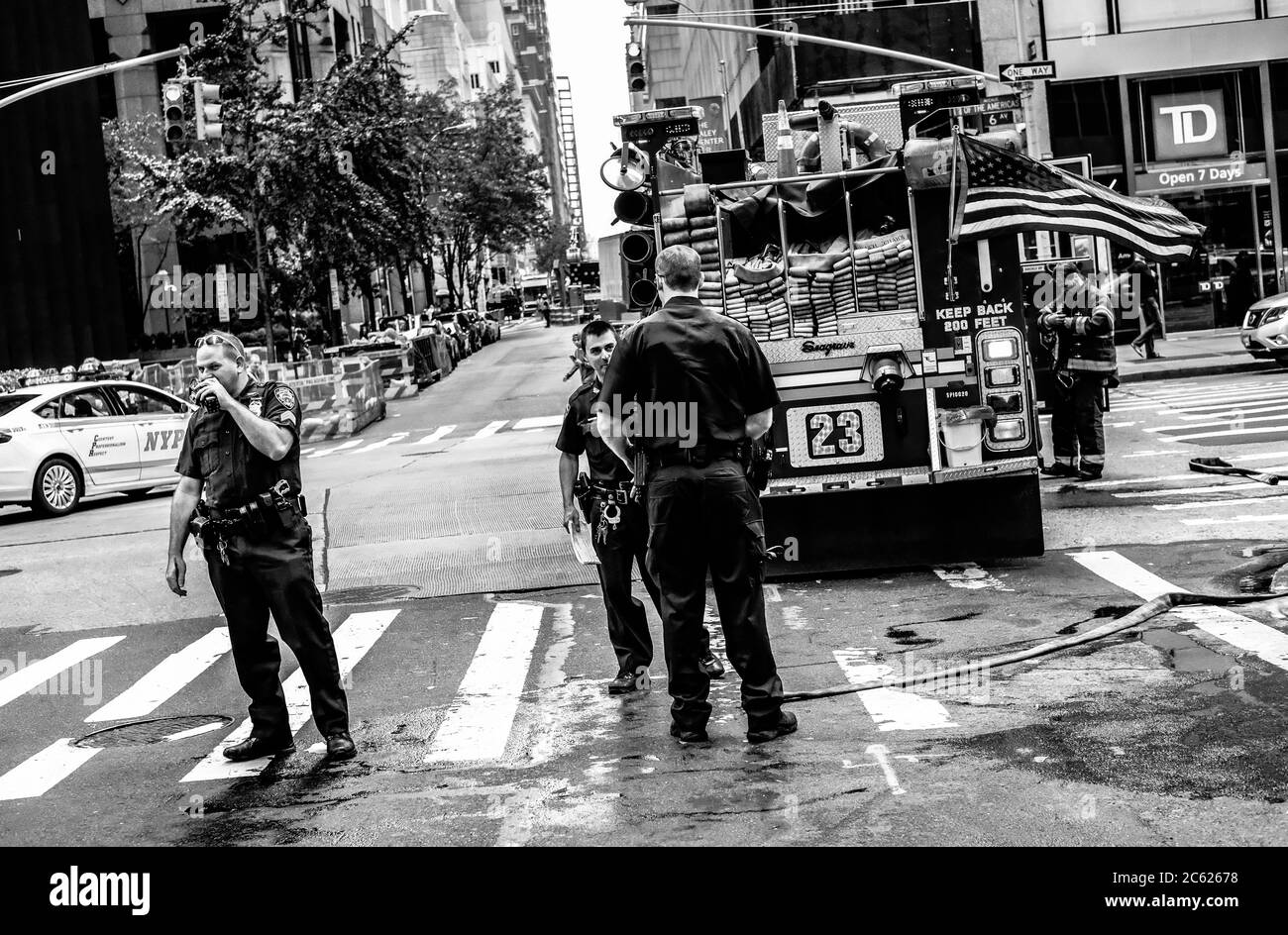 Both NYPD and Fire Department officers attending a fire near a busy New York road. Stock Photo