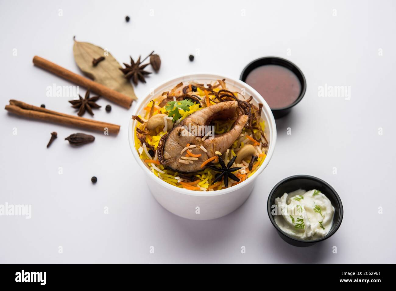 Restaurant Style Fish Biryani Or Pulao Packed For Home Delivery In Plastic Box Or Container With Raita And Salan Stock Photo Alamy