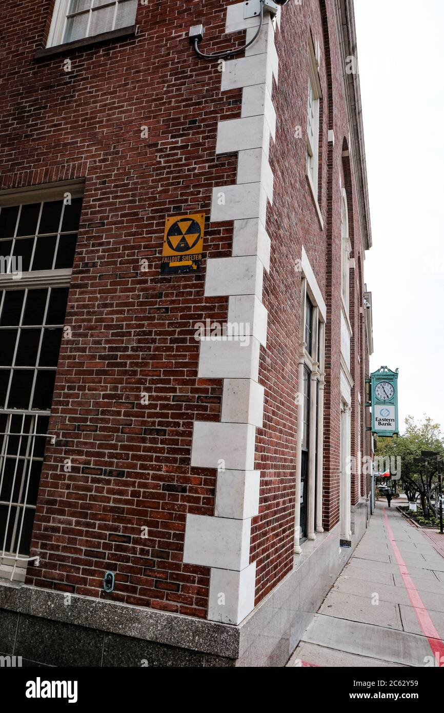 Vintage nuclear fallout sign seen fixed to a building in a US eastern town. Stock Photo