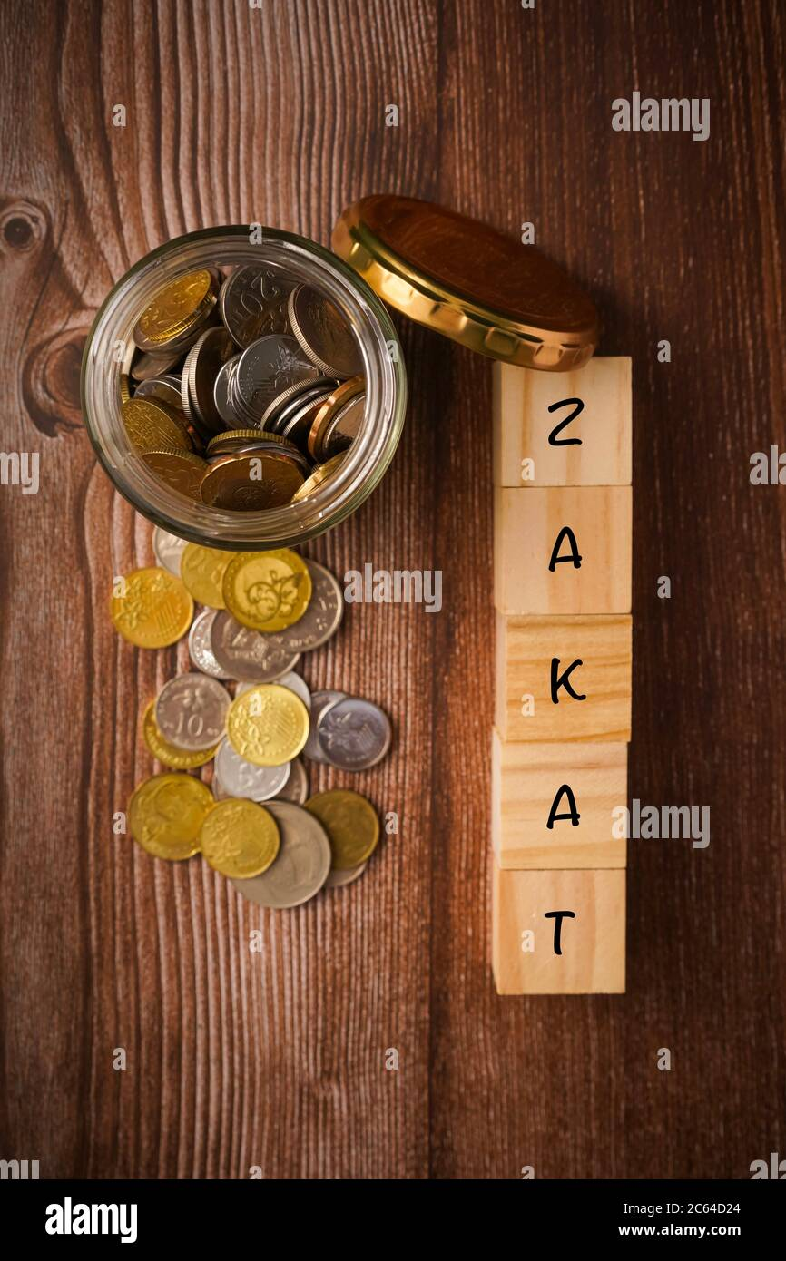 zakat islamic concept zakat wordings wih coins in jar on wooden background stock photo alamy alamy