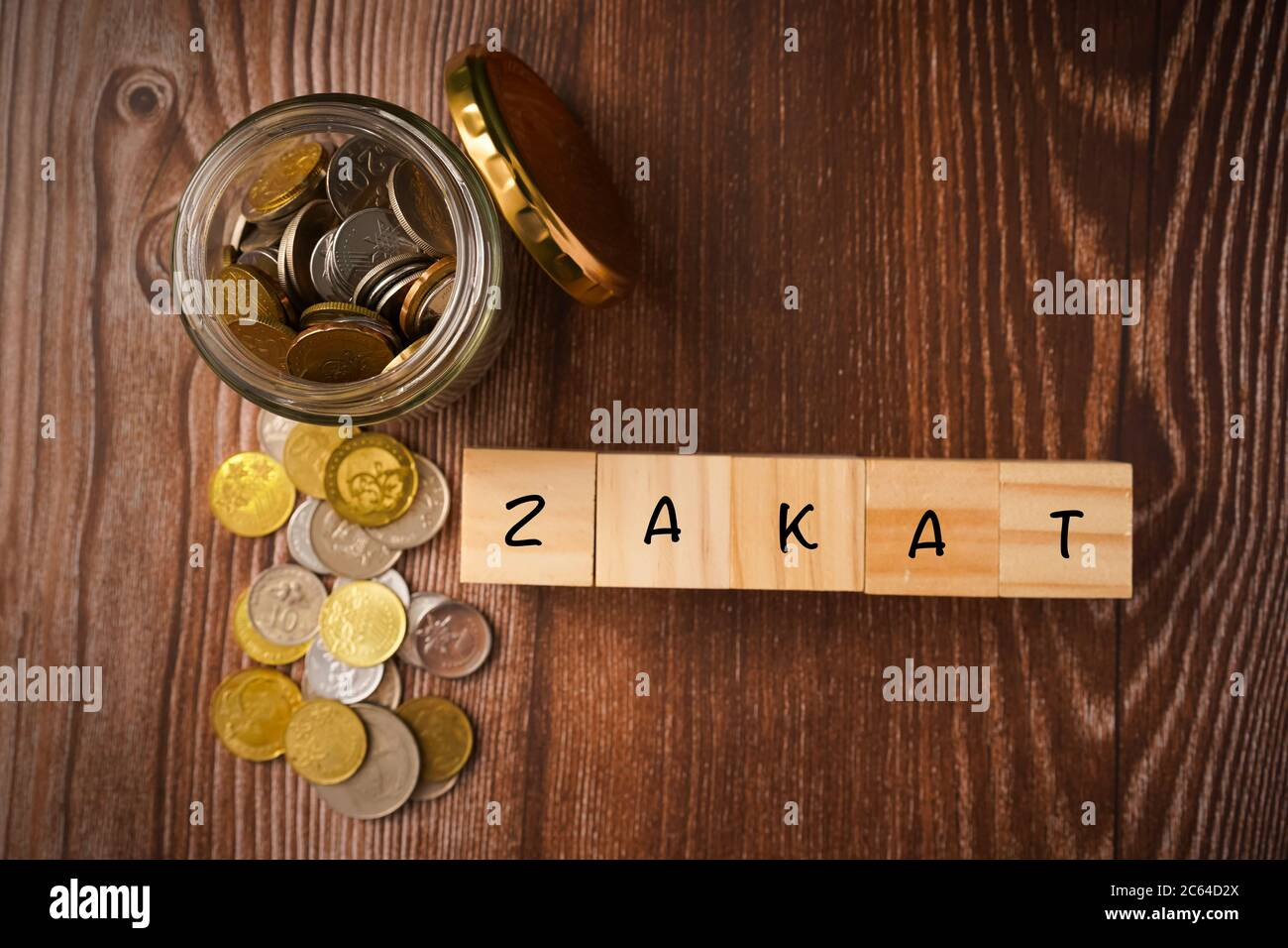 zakat islamic concept zakat wordings wih coins in jar on wooden background stock photo alamy https www alamy com zakat islamic concept zakat wordings wih coins in jar on wooden background image365203746 html