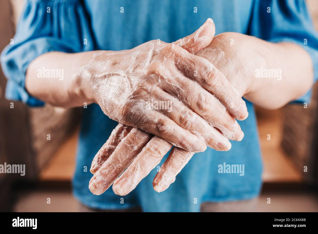 Thick Layer Of Moisturizer On Female Hands Daily Skin Care
