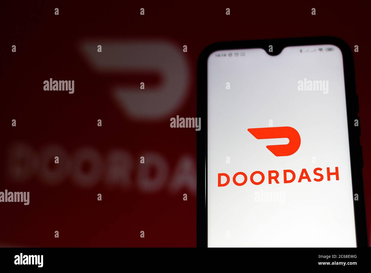 In this photo illustration the DoorDash logo seen displayed on a smartphone. Stock Photo