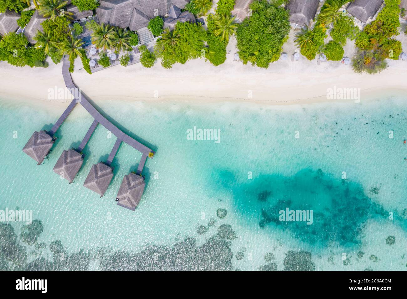 Perfect aerial landscape, luxury tropical resort or hotel with water villas and beautiful beach scenery. Amazing bird eyes view in Maldives, landscape Stock Photo