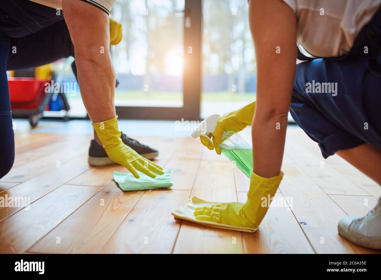 regular clean up. Cleaning people, janitors washing floor with rags and spray. Housekeeping concept. WIndow background Stock Photo