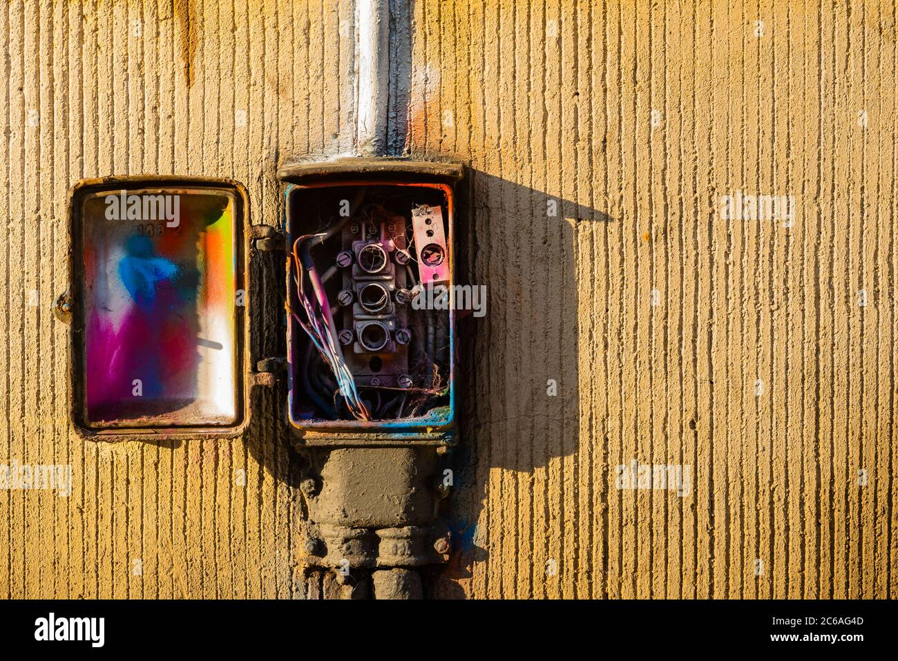 Old fuse box for street lighting, smeared old fuse box, Fuse box on a house wall Stock Photo
