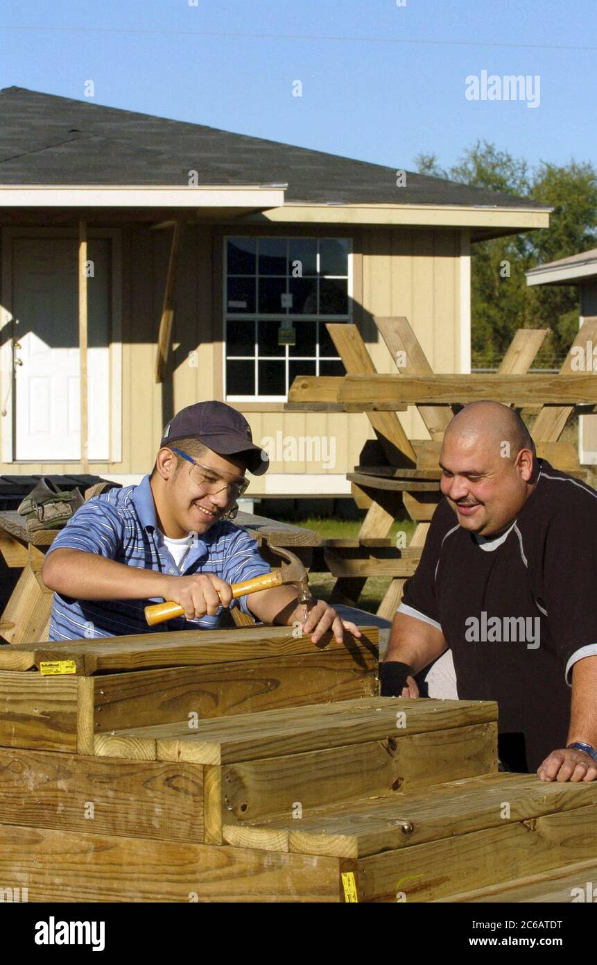San Juan Tx 17dec04 Hispanic Father And 15 Year Old Son Work On Stairs For New House In Volunteer Housing Project They Purchased A Home Through Proyecto Azteca A Low Income Housing Assistance