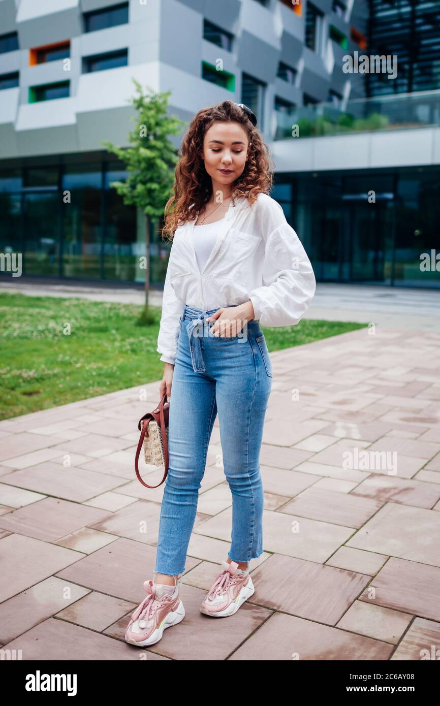 Outdoor Portrait Of Stylish Woman Young Girl Wearing Jeans Shirt And Sneakers Summer Clothes Shoes Stock Photo Alamy