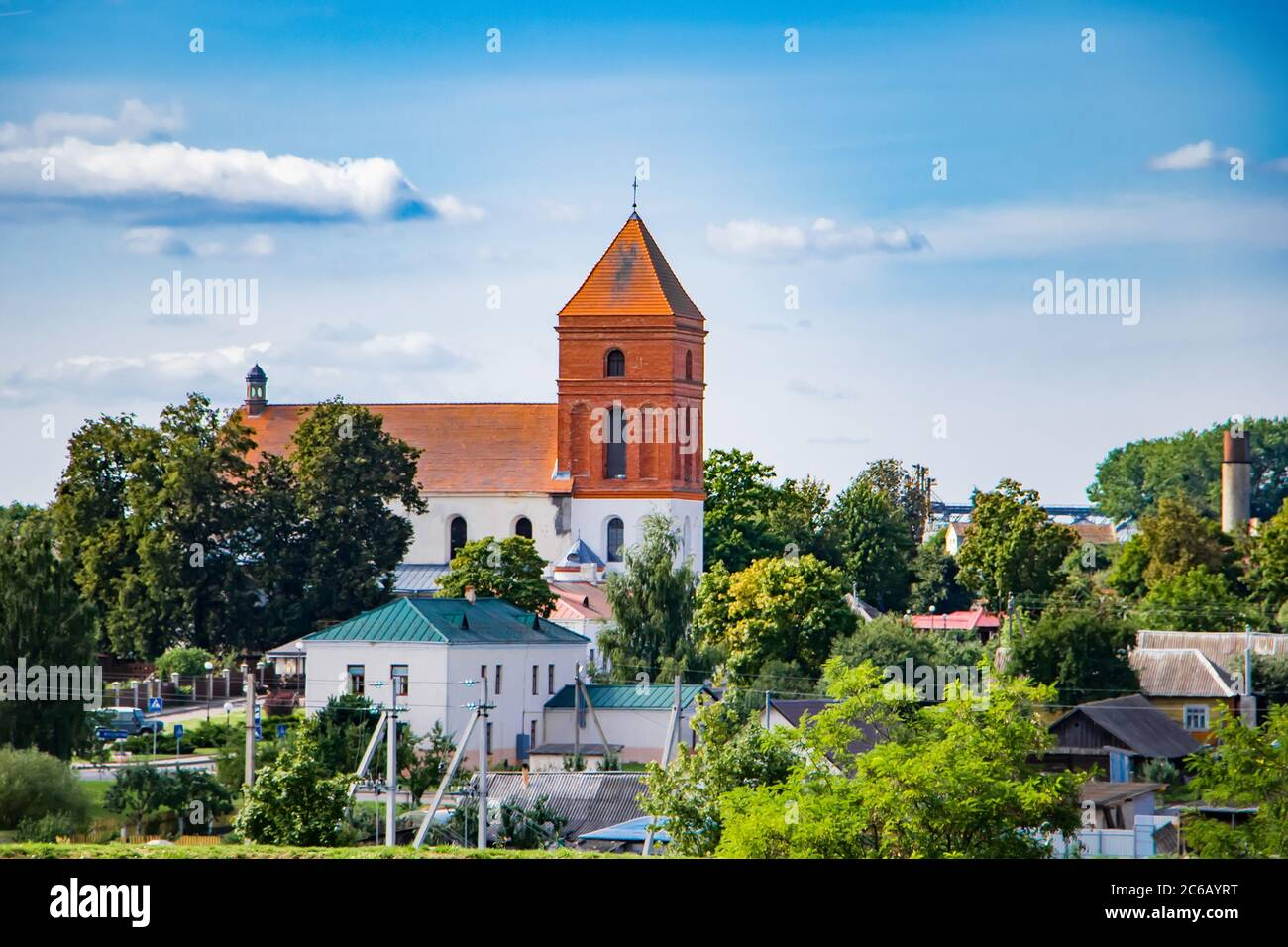 Old medieval building against the blue sky. Ancient architecture. House with red roof tiles. Stock Photo