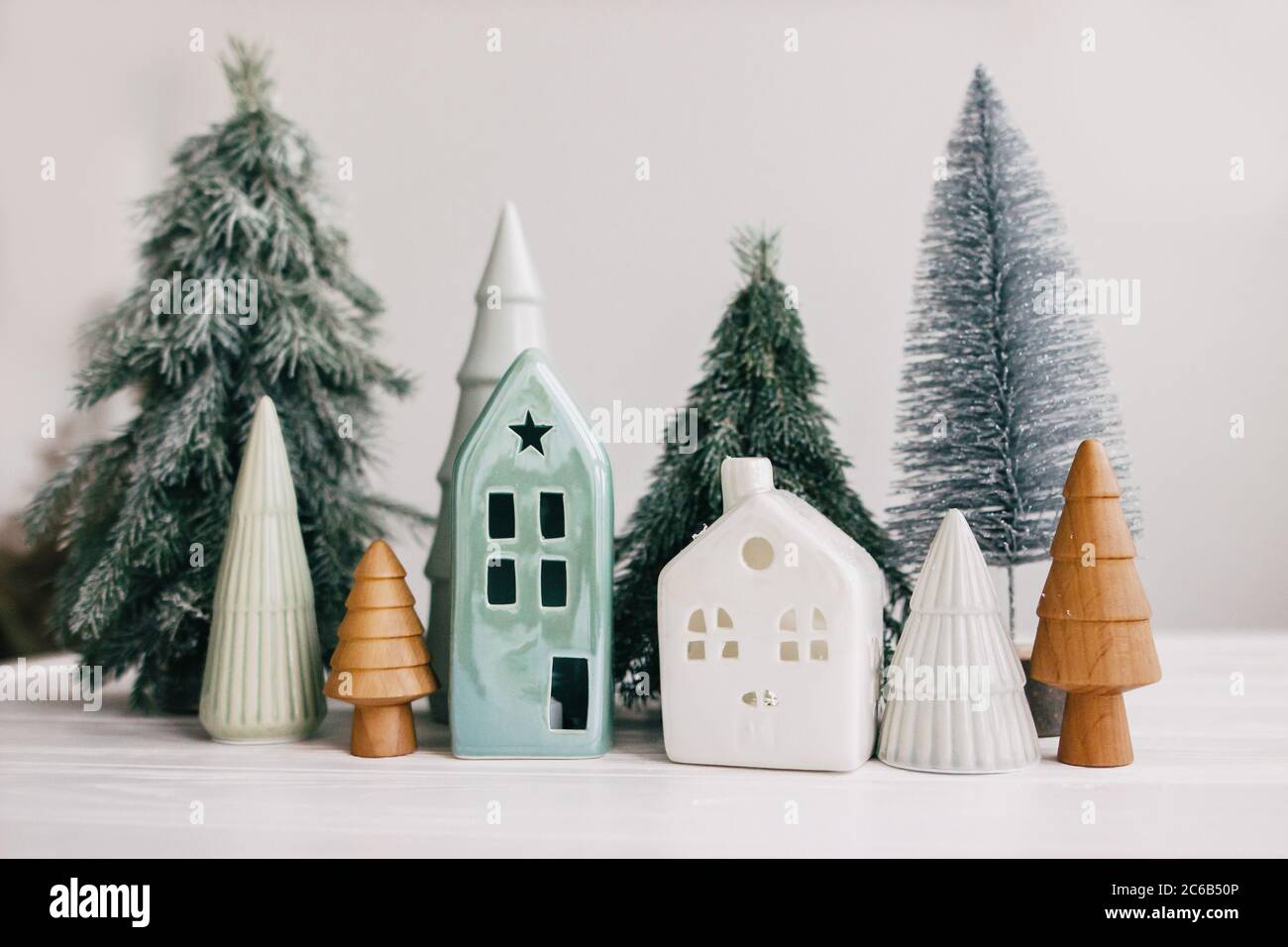 Happy Holidays Miniature Cozy Village Ceramic Houses Wooden And Handmade Christmas Trees Christmas Little Houses And Trees On White Background Fe Stock Photo Alamy