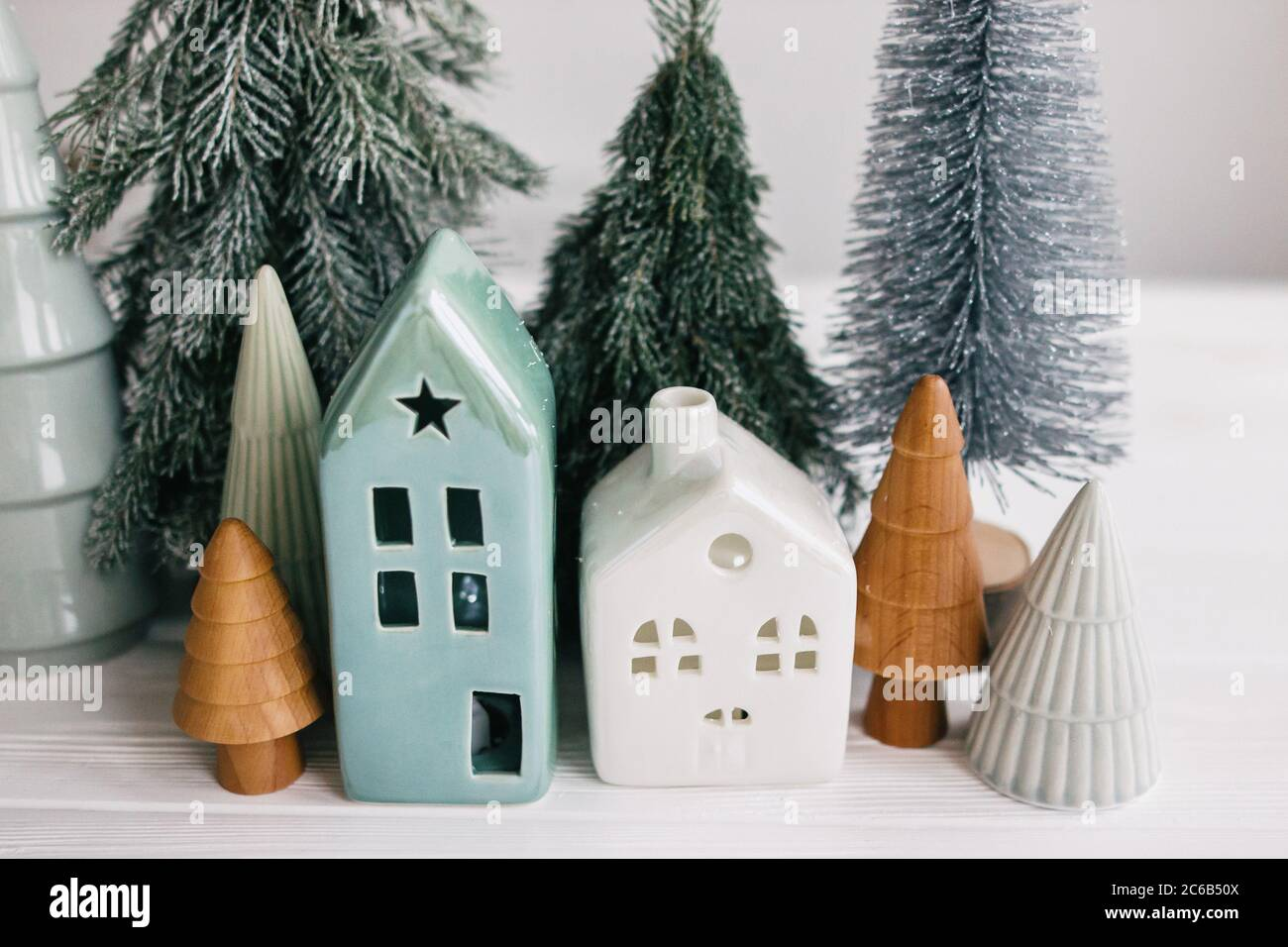 Christmas Little Houses And Trees On White Background Holiday Festive Decor Miniature Village Ceramic Houses Wooden Christmas Trees And Handmade P Stock Photo Alamy