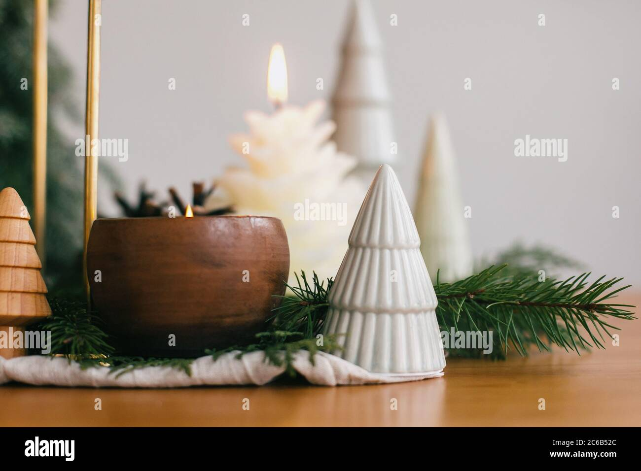Christmas Trees Candles And Pine Cones On Rustic Fabric On Wooden Table Festive Modern Decor Zero Waste Miniature Wooden And Handmade Pine Trees Stock Photo Alamy
