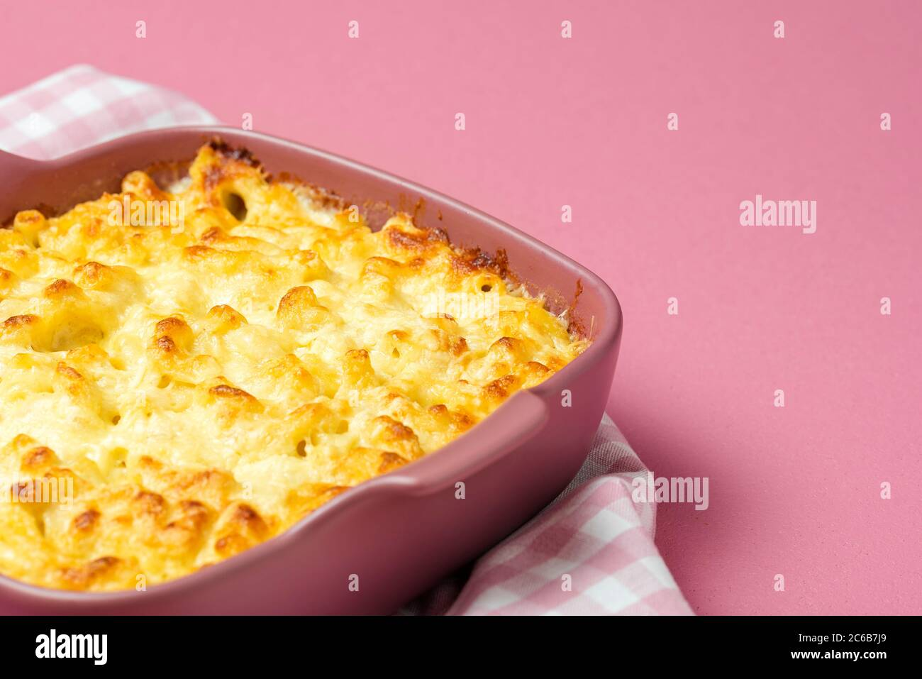 Mac And Cheese Cooked With Bechamel Sauce In A Pink Tray Close Up With Macaroni And Cheese In An Oven Tray On A Pink Background Stock Photo Alamy Download 94,144 pink background free vectors. https www alamy com mac and cheese cooked with bechamel sauce in a pink tray close up with macaroni and cheese in an oven tray on a pink background image365353137 html