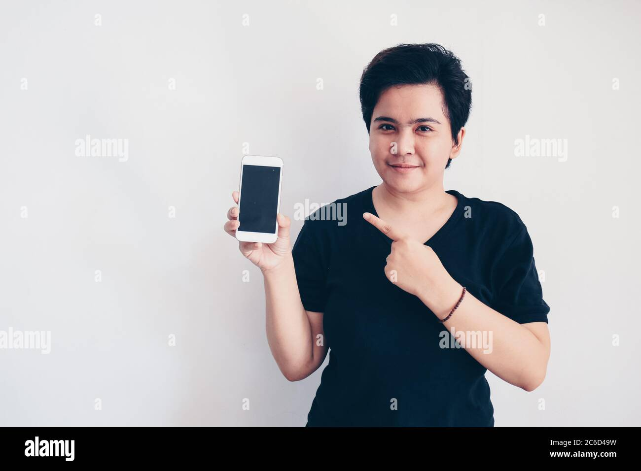 Young Beautiful Short Hair Asian Woman Holding Blank Black Screen Smart Phone On White Background Indonesia Women Stock Photo Alamy