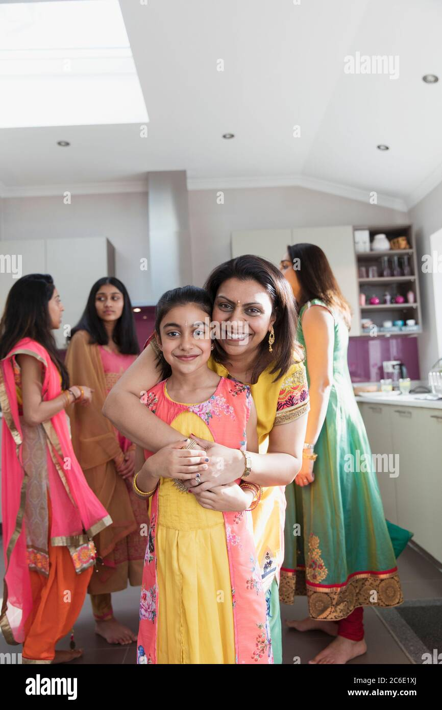 Portrait Happy Indian Mother And Daughter In Saris Hugging In Kitchen Stock Photo Alamy