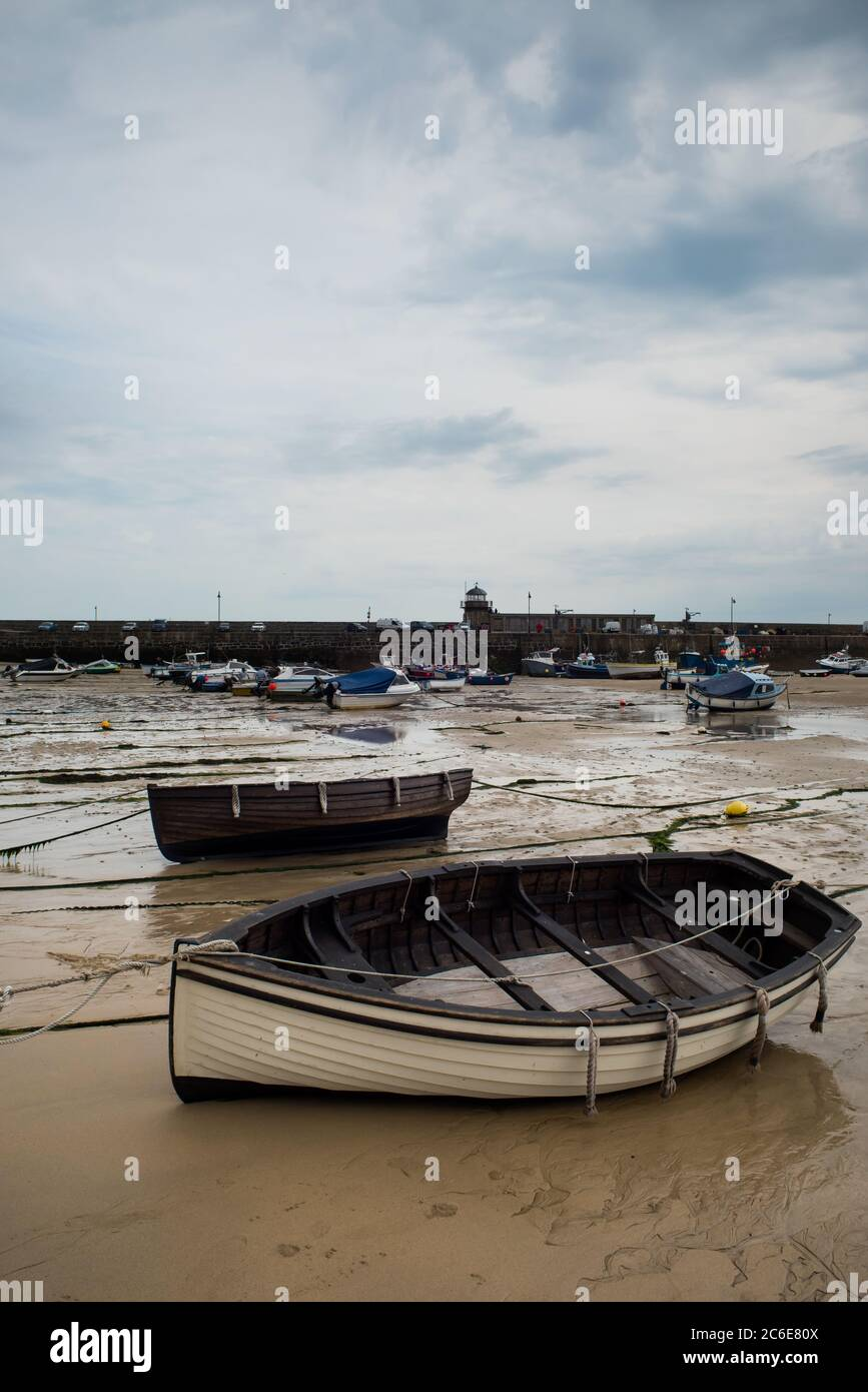 View of boats in St. Ives beach at low tide in Cornwall in England Stock Photo