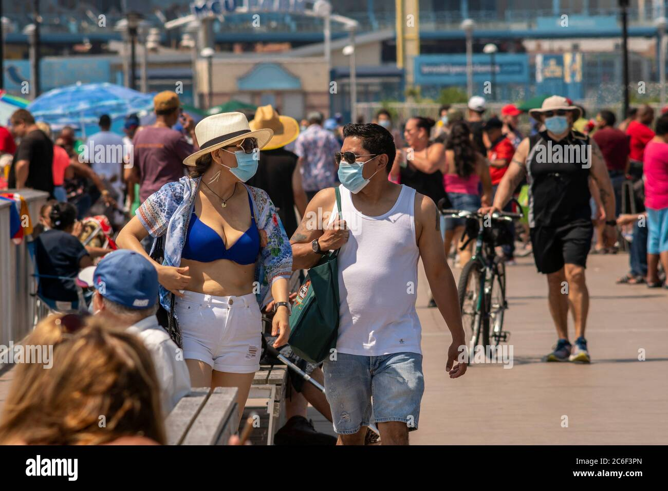 Thousands of beachgoers generally observe social distancing as they try to beat the heat and humidity at Coney Island in Brooklyn in New York on the long Independence Day weekend, Sunday, July 5, 2019.  (© Richard B. Levine) Stock Photo