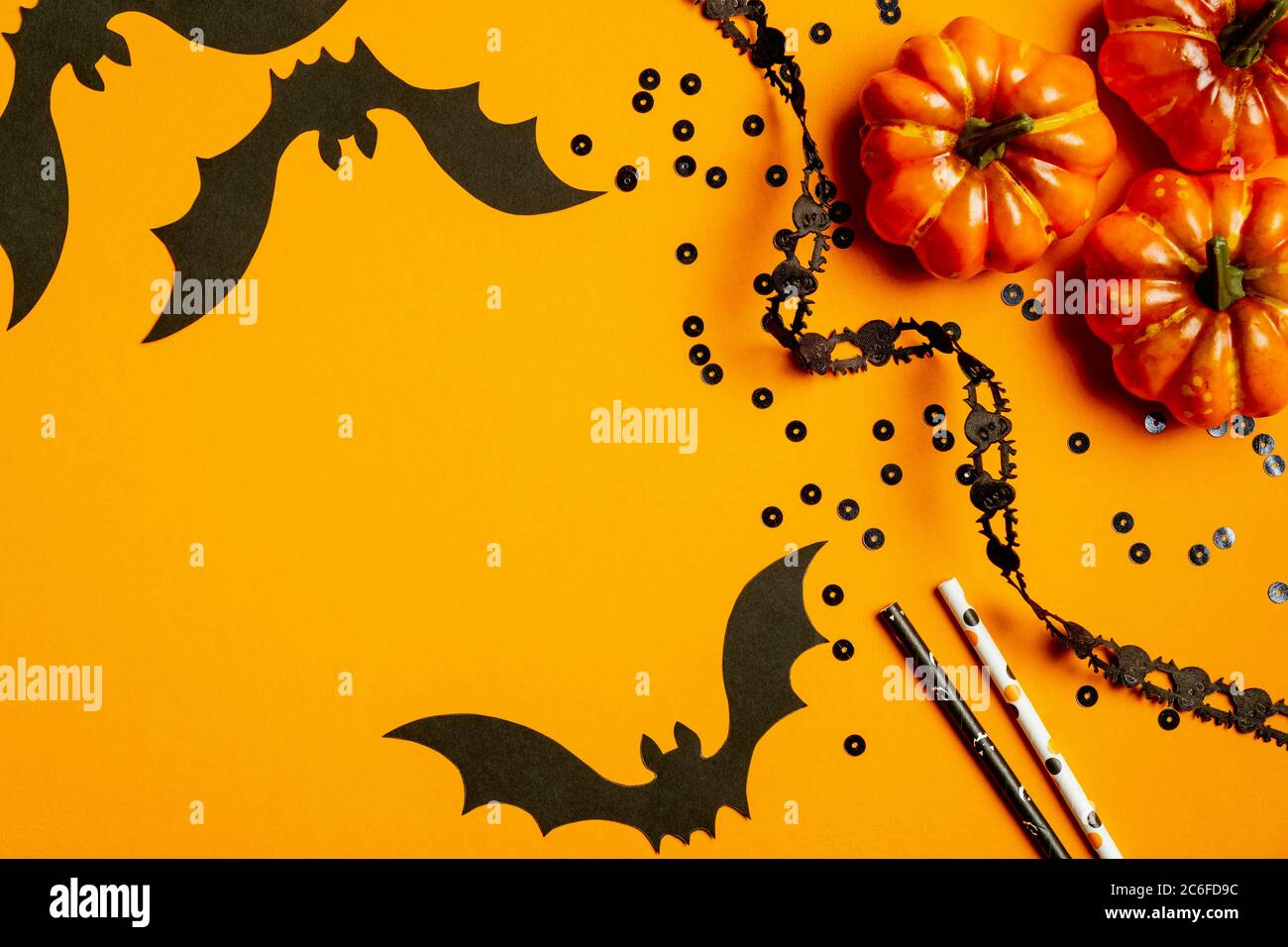 Flat lay position with halloween party decorations bats