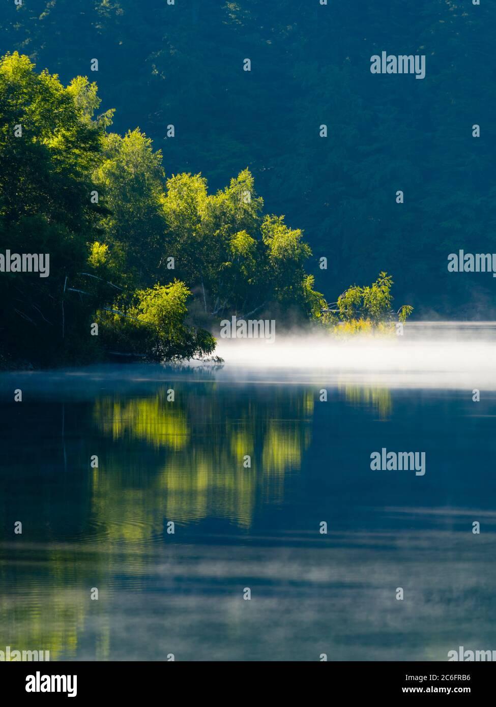 Green forest beautiful pretty majestic stunning lake Mrzla vodica in Croatia Europe photogenic Stock Photo