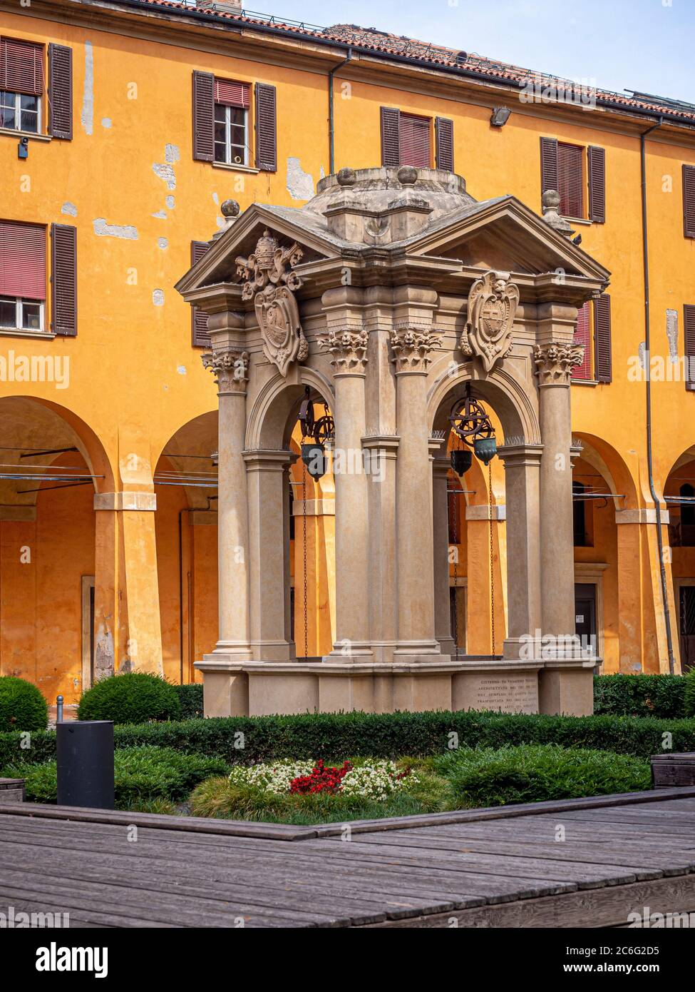Pozzo dei desideri. Wishing well in the courtyard of Palazzo Comunale. Bologna, Italy. Stock Photo