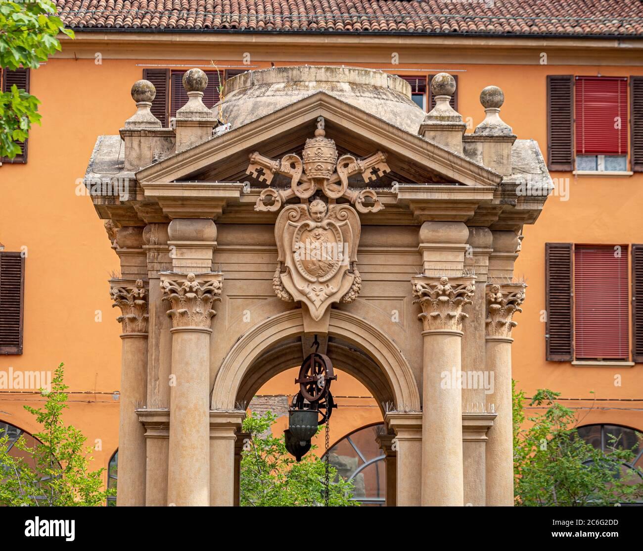 Pozzo dei desideri. Wishing well in the courtyard of Palazzo Comunale. Bologna, Italy. Stock Photo