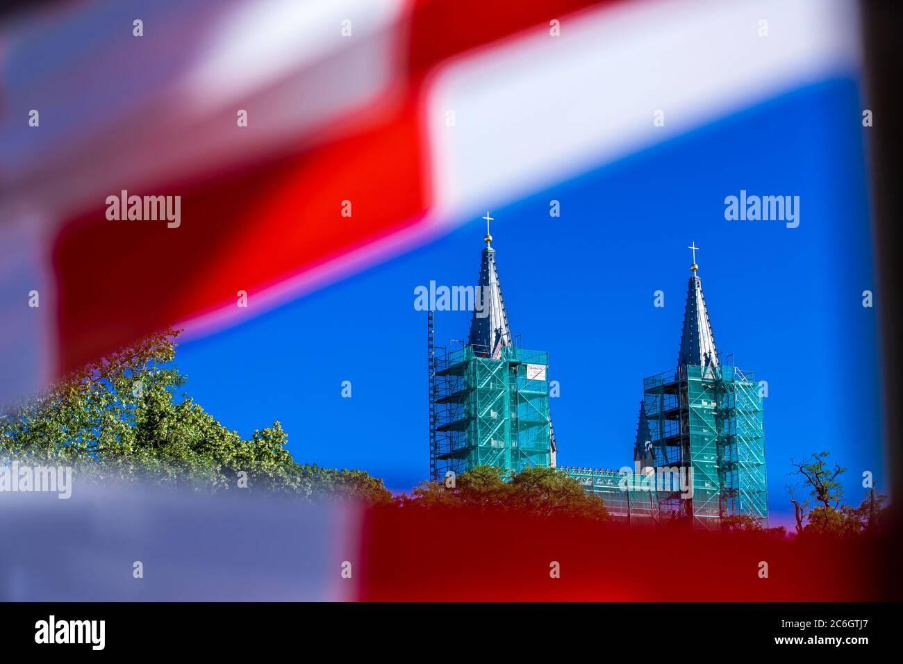 Neustrelitz, Germany. 23rd June, 2020. The castle church is completely scaffolded due to renovation work. The neo-Gothic church on Hertelstraße was built between 1855 and 1859. Credit: Jens Büttner/dpa-Zentralbild/ZB/dpa/Alamy Live News Stock Photo