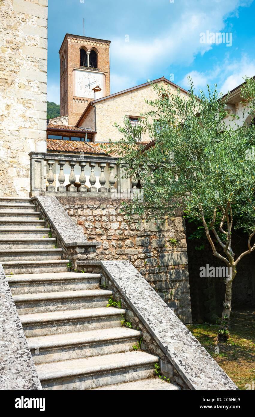 Follina, Italy, the Cistercian Abbey of Santa Maria seen from the garden Stock Photo