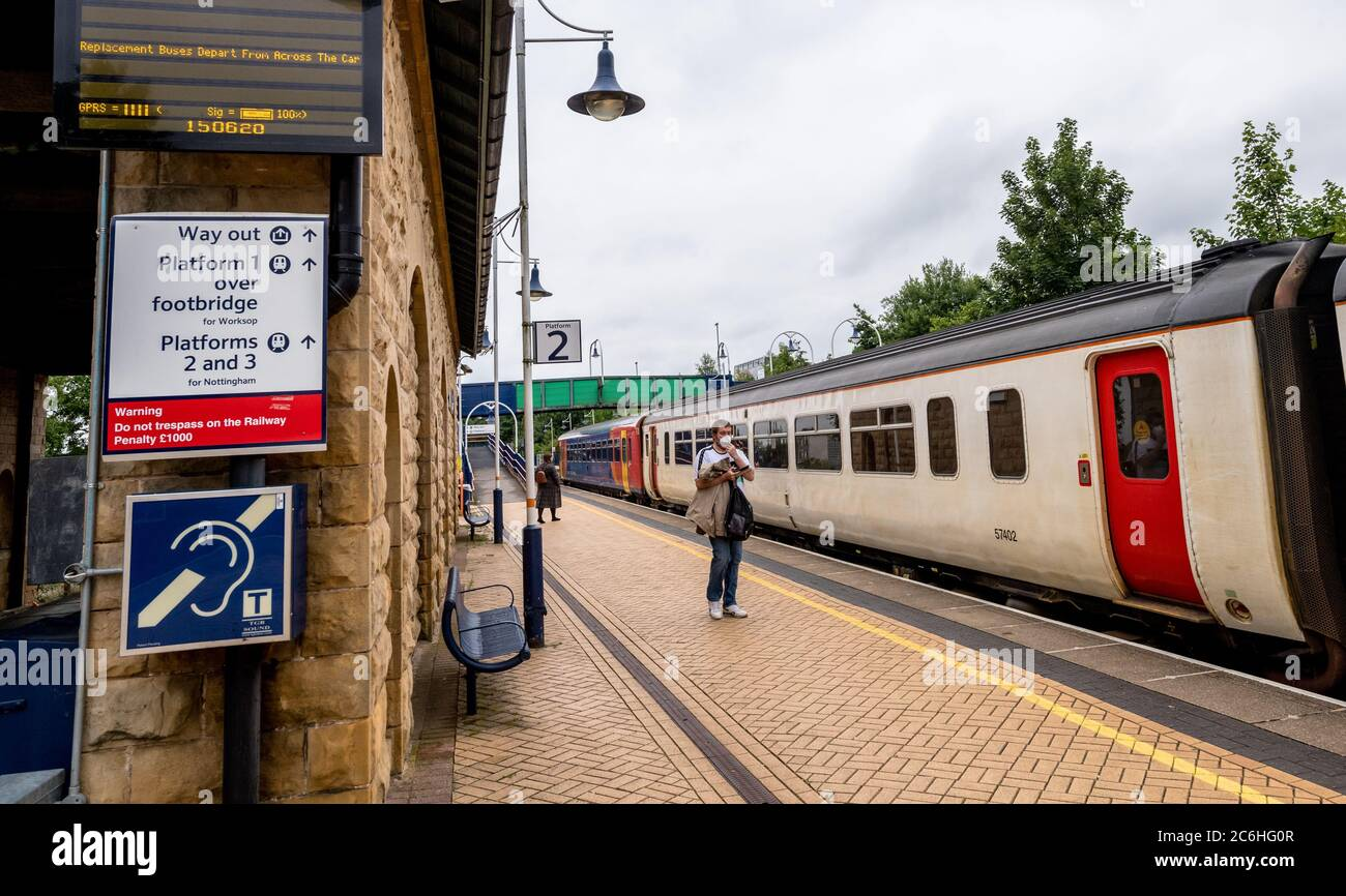 Rail franchise East Midlands Railway mandatory for all passengers to wear face coverings or masks whilst train during the covid19 pandemic. Stock Photo