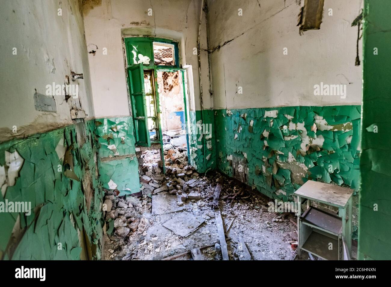 Ruined Corridor With Piles Of Garbage In Abandoned Asylum Stock Photo Alamy