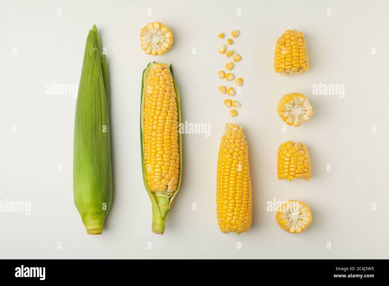 Flat lay with fresh corn on white background, top view Stock Photo