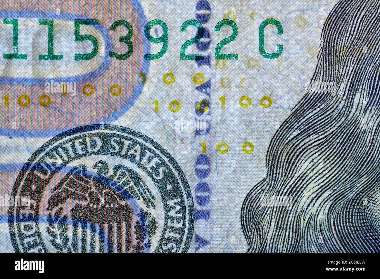 Security thread imprinted with alternating letters USA and the numeral 100 used on US$100 banknote (2009 A series) as a security feature. Stock Photo