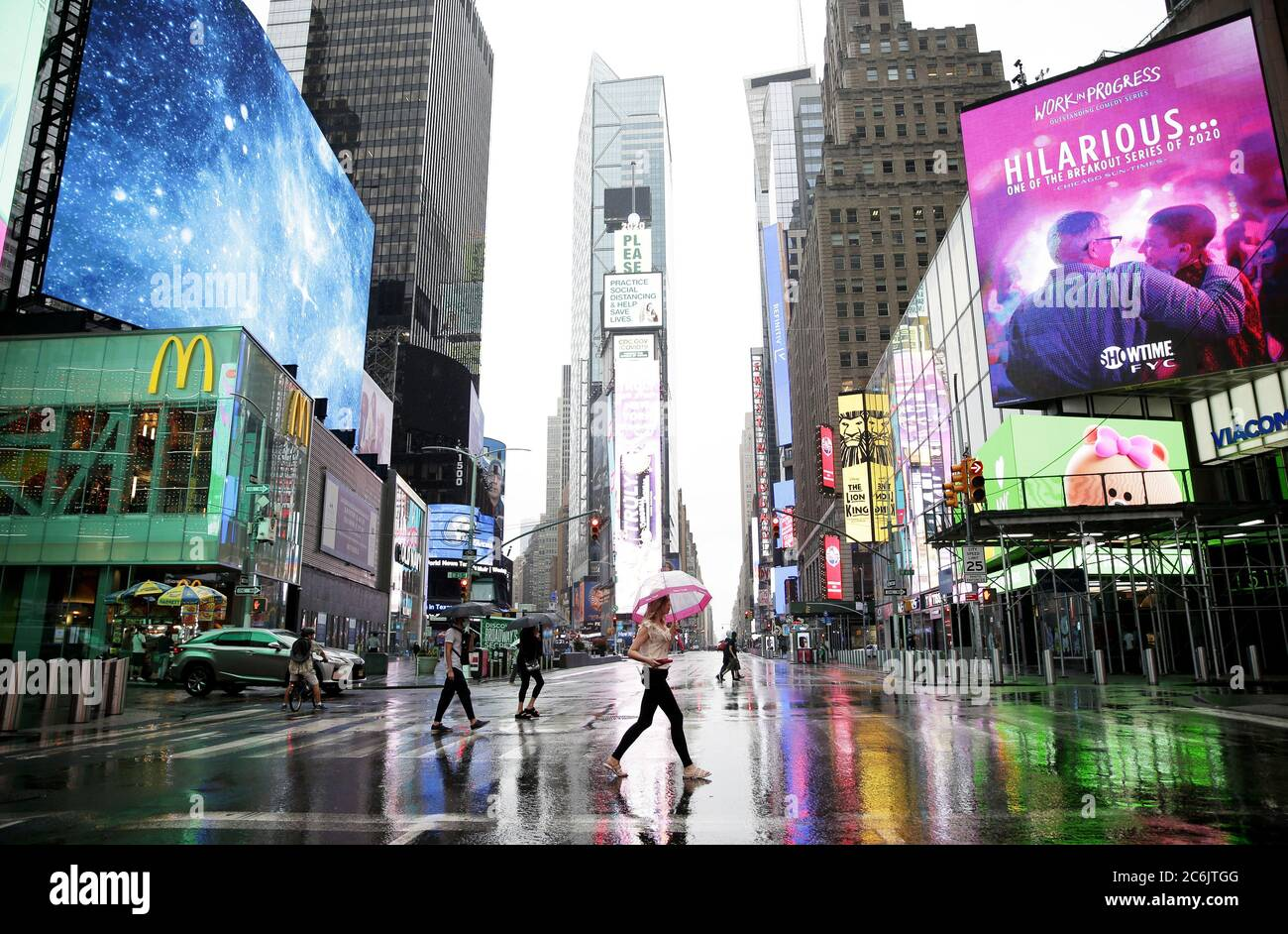 New York, United States. 10th July, 2020. Pedestrians carry umbrellas while walking in Times Square as tropical storm Fay approaches New York City on Friday, July 10, 2020. A tropical storm warning was up for some of Delaware, New Jersey, New York and Connecticut and is expecting wind gusts approach 50 mph in some locations during the day on Friday. Photo by John Angelillo/UPI Credit: UPI/Alamy Live News Stock Photo