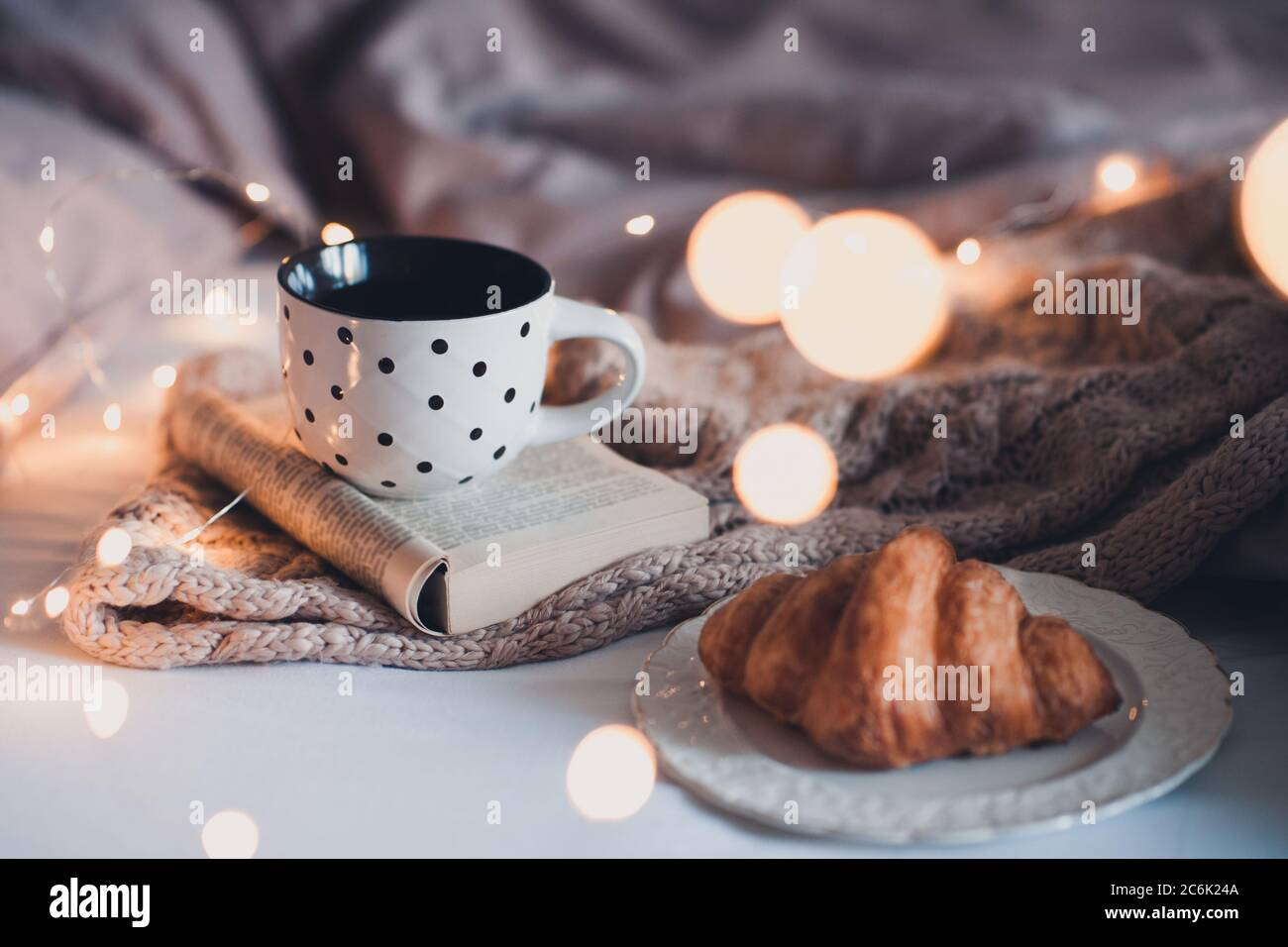 Mug Of Fresh Black Tea With Tasty Croissant And Knitted Textile In Bed Over Glowing Lights Winter Holiday Season Stock Photo Alamy