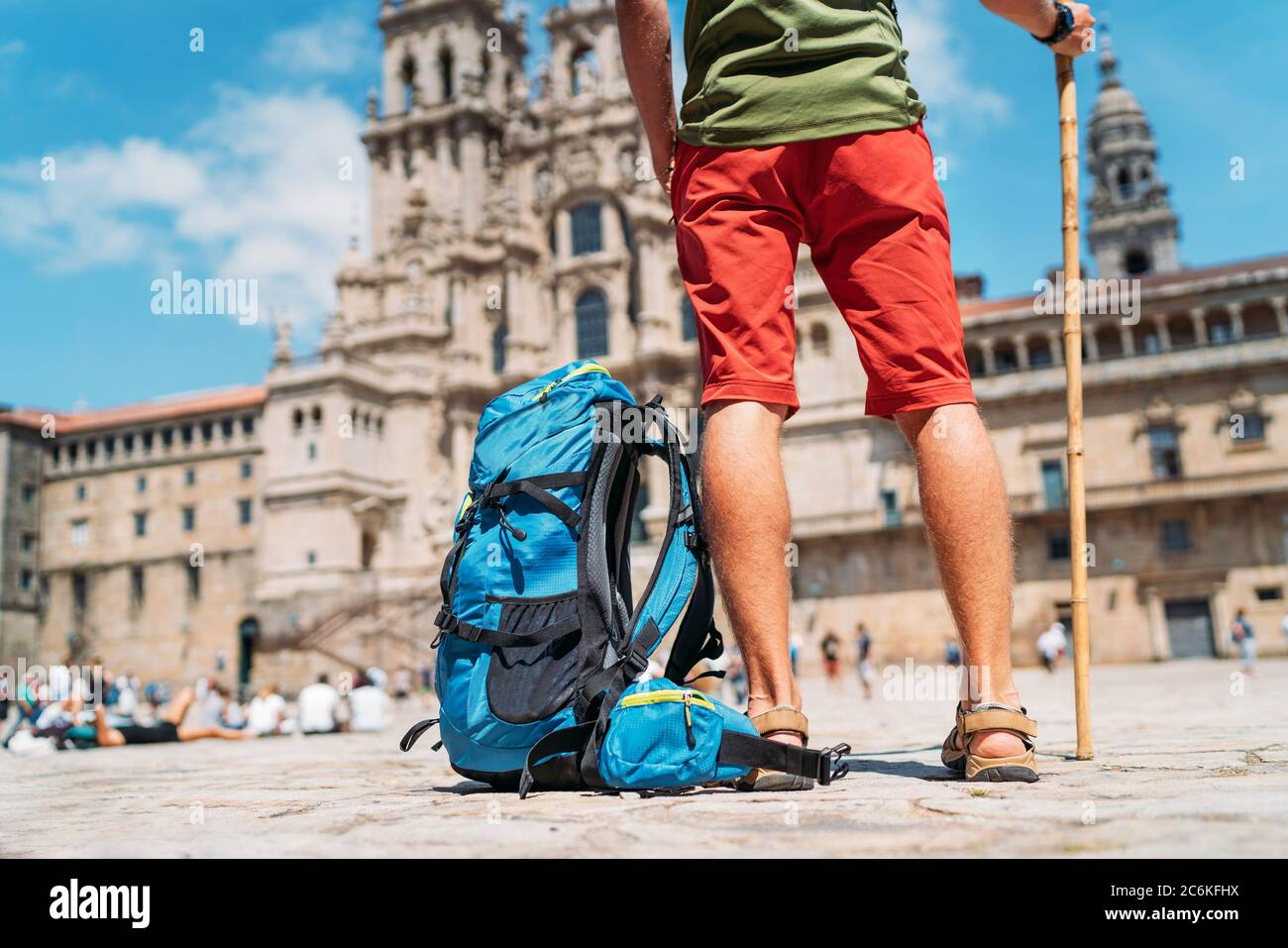 Tired Legs Close up photo of Young backpacker man pilgrim standing on the Obradeiro square (plaza) - the main square in Santiago de Compostela as a en Stock Photo