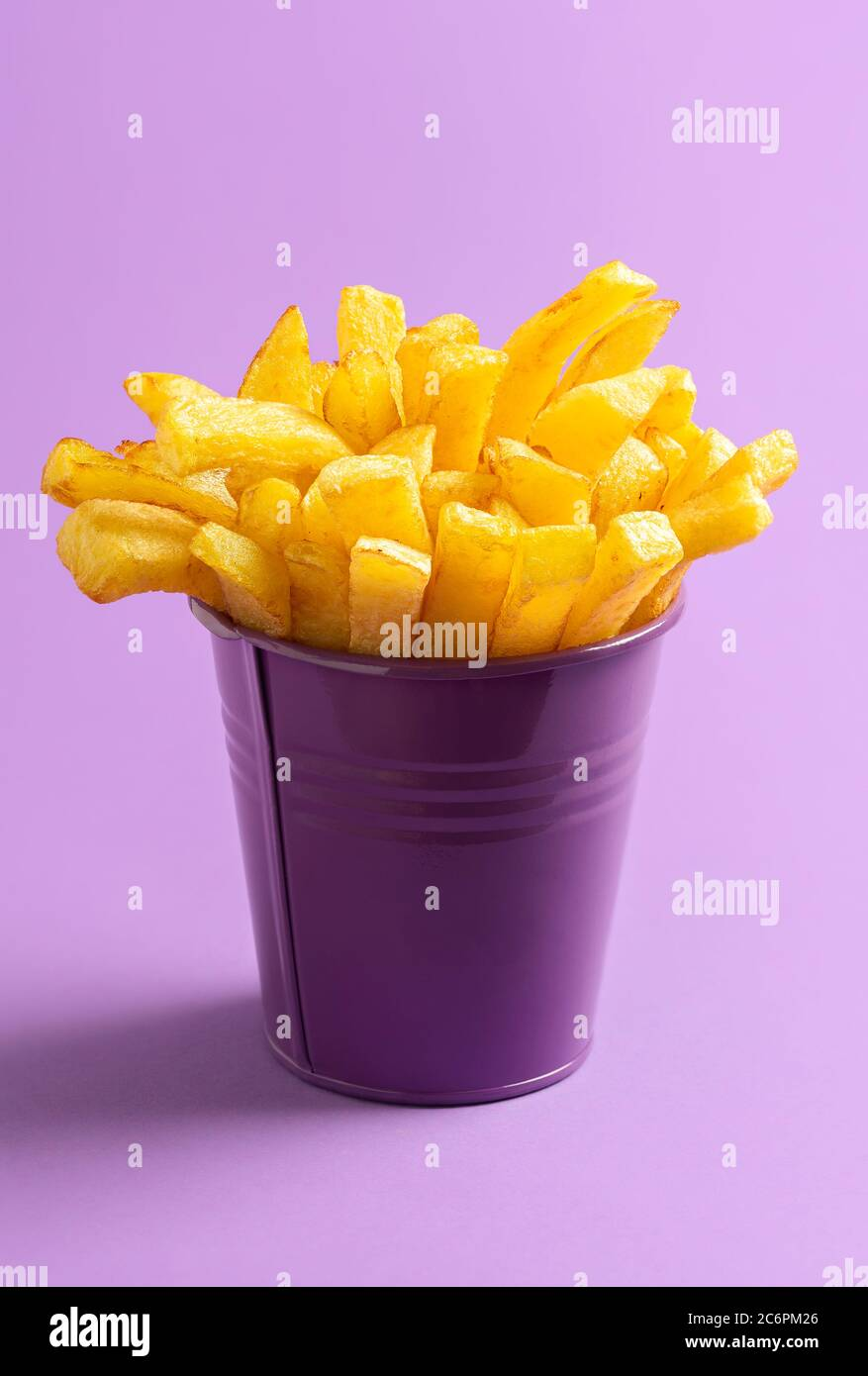 Bucket Of French Fries Isolated On Purple Seamless Background Golden Deep Fried Potatoes In A Purple Bucket Homemade Finger Chips Fast Food Recipe Stock Photo Alamy