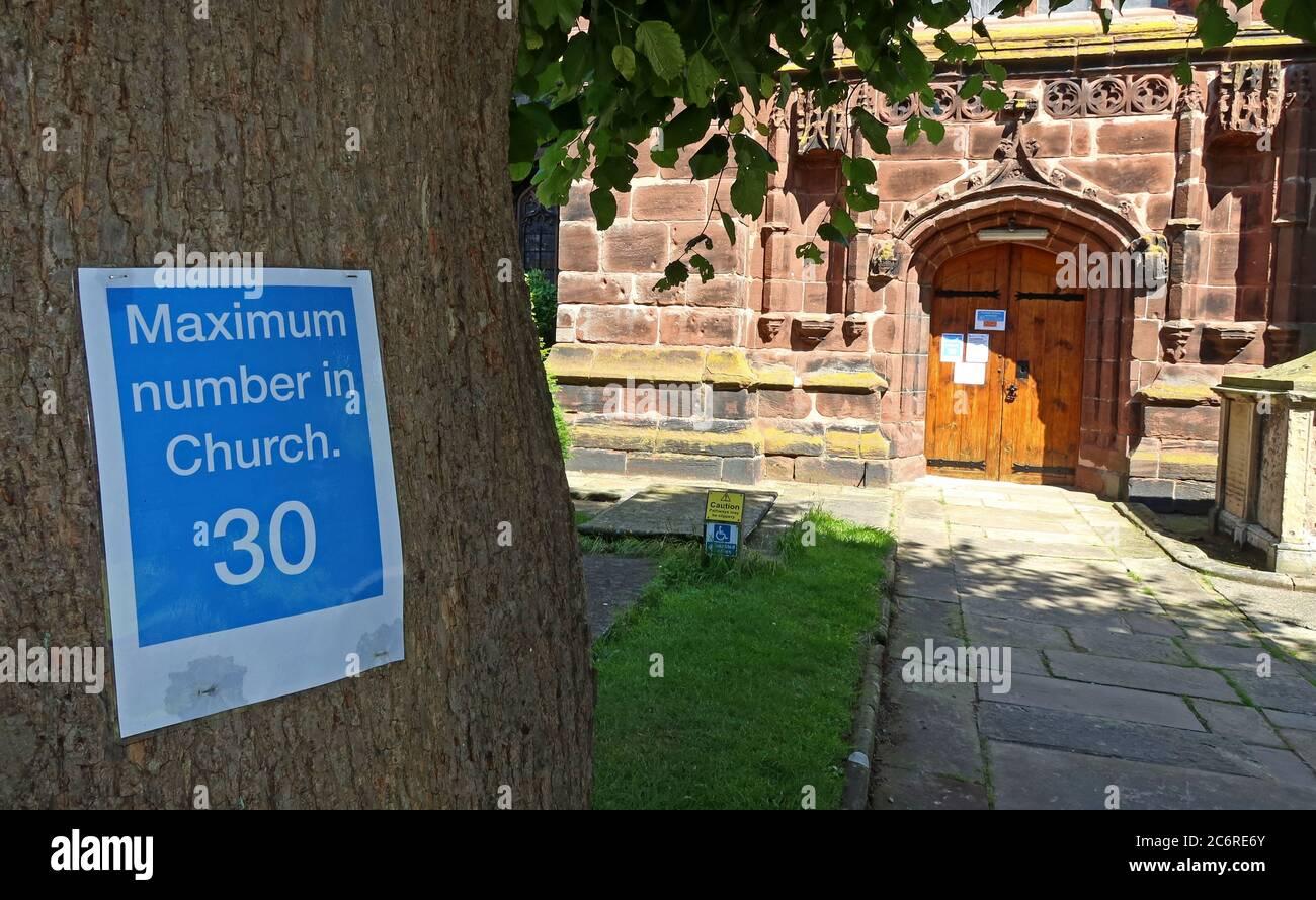St Andrews Church Tarvin, Cheshire, England, UK, Please, Maximum in church 30 sign,Covid19,Coronavirus, precautions Stock Photo